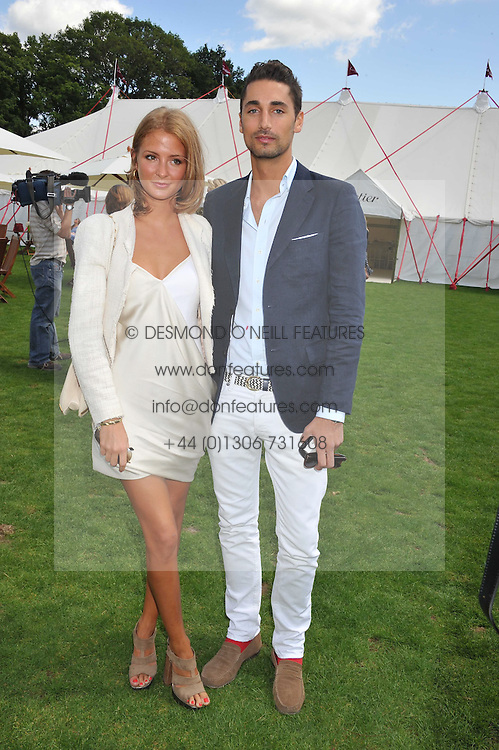 HUGO TAYLOR and MILLIE MACKINTOSHat the 27th annual Cartier International Polo Day featuring the 100th Coronation Cup between England and Brazil held at Guards Polo Club, Windsor Great Park, Berkshire on 24th July 2011.