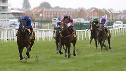 Kessaar and Frankie Dettori lead the field home to win The Dubai Duty Free Mill Reef Stakes Race run during day two of Dubai Duty Free International Weekend at Newbury Racecourse.