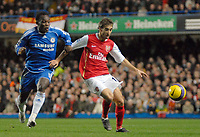 Photo: Ed Godden.<br /> Chelsea v Arsenal. The Barclays Premiership. 10/12/2006.<br /> Chelsea's Michael Essien (L), closes in on Matthieu Flamini.