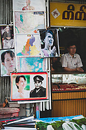 Yangon, Myanmar - October 22, 2011: Posters of Aung San Suu Kyi and her father, Aung San, are for sale on a sidewalk in Yangon, Myanmar.