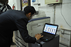 April 3, 2017 - Kathmandu, NP, Nepal - Staff of Election Commission arranging photo copies of voters' identity cards at Election Commission Building, Kathmandu, Nepal on Monday, April 03, 2017. Chief Election Commissioner Dr. Ayodhi Prasad Yadav inaugurated the voters' identity cards printing task at Election Commission premises. The Election Commission has started printing voters' identity cards for upcoming local level election scheduled on May 14, 2017. The Election Commission approved the name of 14.54 million voters for the local level election on Sunday, April 02, 2017. (Credit Image: © Narayan Maharjan/Pacific Press via ZUMA Wire)