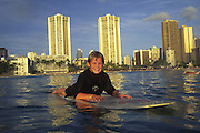 Boy surfing, Waikiki, Oahu, Hawaii<br />