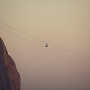 The cable cars head to and from the summit of Suger Loaf Mountain, one of the iconic locations with breathtaking views of Rio de Janeiro, Brazil. 22nd July 2010. Photo Tim Clayton..