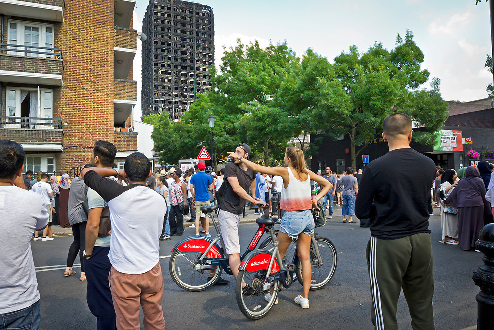 18July 2017 taken between the hours of 15.51 - 16.49<br /> The Grenfell Tower fire occurred on 14 June 2017 at the 24-storey, 220-foot-high (67 m), Grenfell Tower block of public housing flats in North Kensington, Royal Borough of Kensington and Chelsea, West London. It caused at least 80 deaths and over 70 injuries. A definitive death toll is not expected until at least 2018. As of 5 July 2017, 21 victims had been formally identified by the Metropolitan Police. Authorities were unable to trace any surviving occupants of 23 of the flats.<br /> <br /> Emergency services received the first report of the fire at 00:54 local time. It burned for about 60 hours until finally extinguished. More than 200 firefighters and 45 fire engines from stations all over London were involved in efforts to control the fire. Many firefighters continued to fight pockets of fire on the higher floors after most of the rest of the building had been gutted. Residents of surrounding buildings were evacuated due to concerns that the tower could collapse, but the building was later determined to be structurally sound.<br /> <br /> The tower contained 129 flats. Police were unable to trace any survivors from 23 of these, and their occupants are believed to have died in the fire. Firefighters rescued 65 people. Seventy-four people were confirmed to be in six hospitals across London, and 17 of them were in a critical condition. The fire started in a fridge-freezer on the fourth floor. The growth of the fire is believed to have been accelerated by the building's exterior cladding.  ( Source Wikipedia}