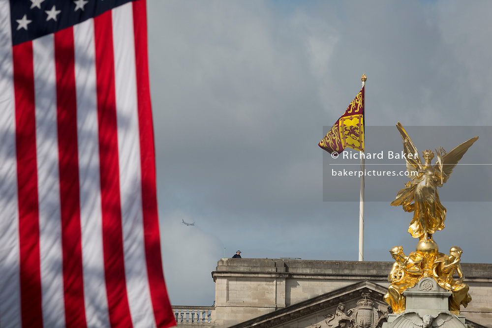 On US President Donald Trump's first day of a controversial three-day state visit to the UK by the 45th American President, The US Stars and Stripes flag hangs next to the Royal Standard flag on the roof of Buckingham Palace, on 3rd June 2019, in London England.