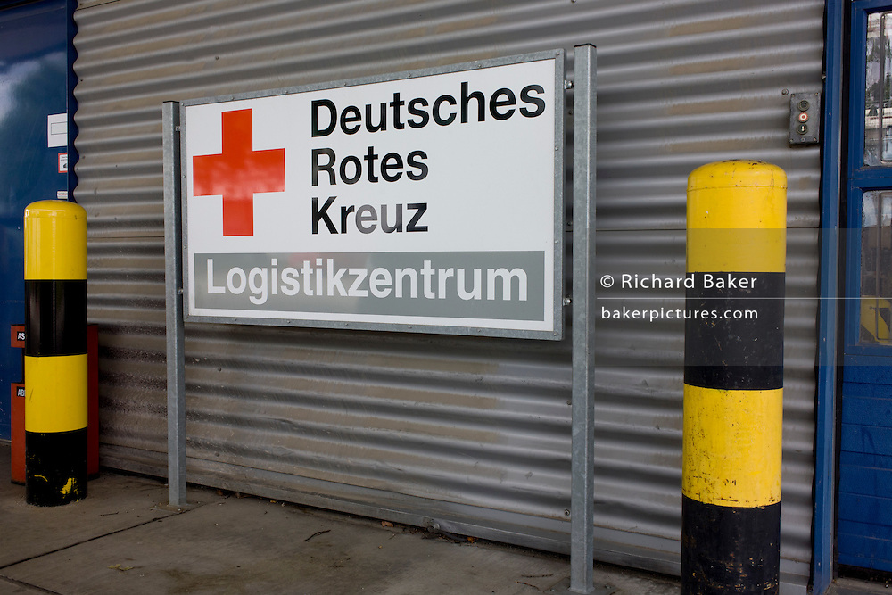 German Red Cross (Deutches Rotes Kreuz - DRK) vehicle logos at their logistics centre at Berlin-Schönefeld airport.