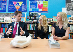 ***UPDATED CAPTION WITH NAMES***© Licensed to London News Pictures. 22/10/2014. London, UK. Nick Clegg talks with teachers, Camille Hazeldene and Jessica Avison (right), about the bureaucracy they face in school work. Deputy Prime Minister Nick Clegg visits a school, Bellville Primary in Clapham, in London on Wednesday 22 October to address an audience of public sector workers - including teachers, social workers, local government and NHS staff, Civil Service apprentices & Fast Streamers. He gave a speech about the public sector as a whole and in it, thanked public sector workers for their hard work through challenging financial times. Photo credit : Stephen Simpson/LNP