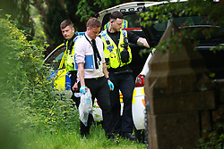 © Licensed to London News Pictures. 03/06/2021. Rochdale, UK. Police off Foxholes Road in Rochdale outside All Saints Hamer and Christ Church Healey Vicarage . It's understood that a woman was found dead in a brook close to the scene this afternoon (Thursday 3rd June 2021). Photo credit: Joel Goodman/LNP