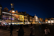 Poznan, Poland - August 29, 2015: Pedestrians on a summer night at Old Market Square in Poznan.