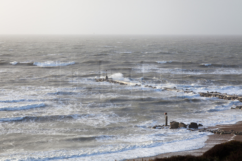 © Licensed to London News Pictures. 06/01/2014. Hengistbury Head, Christchurch, Dorset, UK. Waves roll in from the English Channel and crash against the breakwater at Hengistbury Head near Christchurch in Dorset. Dorset is expected to be one of the worst affect areas, with more heavy rain and flooding forecast. Photo credit : Rob Arnold/LNP