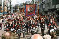 Flute band leads an Orange Lodge through Donegall Place, Belfast, N Ireland, in their annual demonstration on 12th July 1974. 197407120388a<br /> <br /> Copyright Image from Victor Patterson, 54 Dorchester Park, Belfast, UK, BT9 6RJ<br /> <br /> t1: +44 28 9066 1296 (from Rep of Ireland 048 9066 1296)<br /> t2: +44 28 9002 2446 (from Rep of Ireland 048 9002 2446)<br /> m: +44 7802 353836<br /> <br /> victorpattersonbelfast@gmail.com<br /> victorpatterson@me.com<br /> <br /> www.victorpatterson.com<br /> <br /> Please see my Terms and Conditions of Use at https://www.victorpatterson.com/page2<br /> It is IMPORTANT that you familiarise yourself with them.<br /> <br /> Images used on the Internet incur an additional cost and must be visibly watermarked i.e. © Victor Patterson within the body of the image and copyright metadata must not be deleted. Images used on the Internet have a size restriction of 4kbs and are chargeable at rates available at victorpatterson.com.<br /> <br /> This image is available only for the use of the download recipient i.e. television station, newspaper, magazine, book publisher, etc, and must not be passed on to any third party. It is also downloaded on condition that each and every usage is notified within 7 days to victorpatterson@me.com<br /> <br /> The right of Victor Patterson (or the named photographer) to be identified as the author is asserted in accordance with The Copyright Designs And Patents Act (1988). All moral rights are asserted.