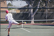 Young Adult Practicing Tennis