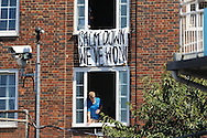 'Calm Down We've Won' banner hanging from apartment window overlooking the ground during the third day of the 5th Investec Ashes Test match between England and Australia at The Oval, London, United Kingdom on 22 August 2015. Photo by Ellie Hoad.