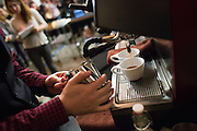 Justin Williams, 25, of Front Café in San Francisco prepares drinks for the judges on a Nuova Simonelli espresso machine during the 2nd Annual Mock Barista Competition and Brewer's Cup at San Pedro Square Market in San Jose, California, on February 21, 2013.  (Stan Olszewski/SOSKIphoto)