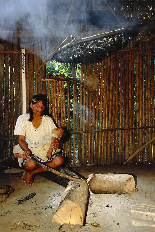 Machiguenga Indian at Cooking Fire<br />Timpia Community, Lower Urubamba River<br />Amazon Rain Forest, PERU.  South America