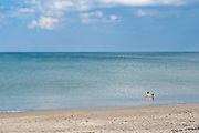 Two people sit in the water at Avalon State Park in Fort Pierce, Florida.