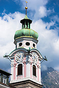 Baroque style 17th Century clock tower of Spitalskirche in Maria Theresien Strasse in Innsbruck, the Tyrol, Austria