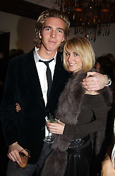 LADY EMILY COMPTON and MR JAMES COOK at a party to celebrate the 4th anniversary of Quintessentially held at 11 Grosvenor Place, London  SW1 on 14th December 2004.<br />