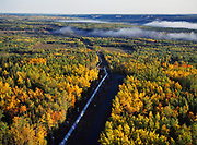 Aerial view of the Trans-Alaska Pipeline crossing boreal foest of spruce, birch and aspen in autumn colors south of Glennallen, Alaska.