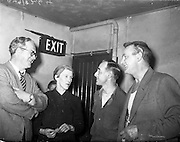 """25/05/1959<br /> 05/25/1959<br /> 25 May 1959<br /> Listowel Drama Group performs """"Sive"""" at the Abbey Theatre (Queens Theatre), Dublin. Kerry author and poet Sigerson Clifford went back stage after the 1st night production of """"Sive"""" by the Listowel Drama Group to congratulate the players. Picture shows Mr Clifford (left) chatting to players Siobhan Cahill, Brian Brennan and Kevin O'Donovan in a dressing room of the Abbey."""