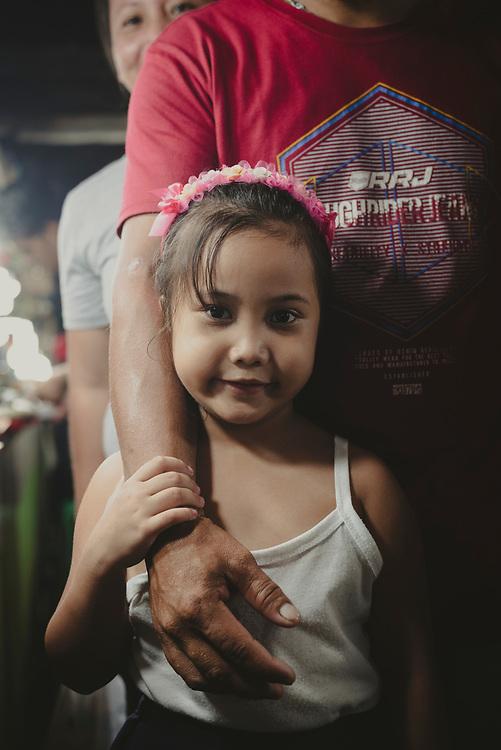 Puerto Princesa, Palawan, Philippines - July 3, 2019: Family at the market in Puerto Princesa.