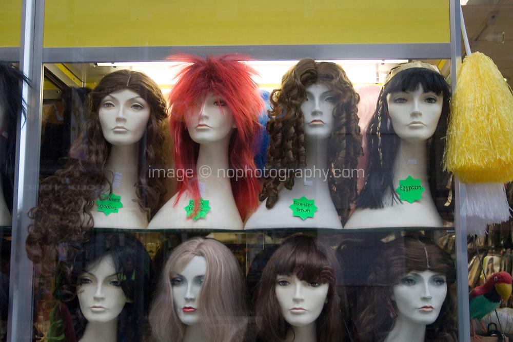 Display of wigs in joke shop window in Dublin Ireland