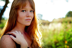 Young Woman with Red Hair Outdoors
