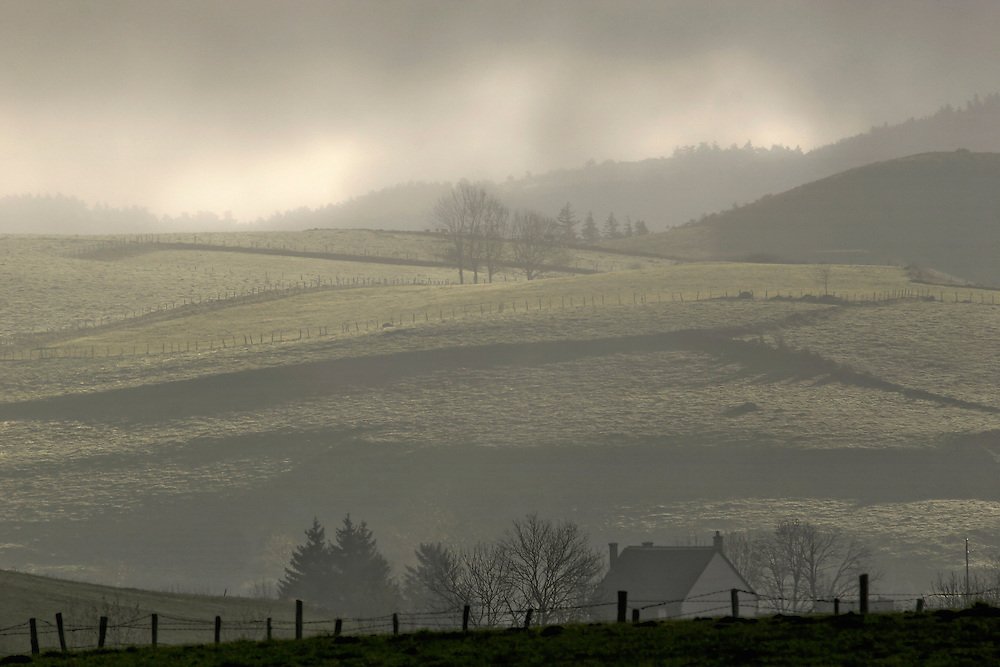 Morning mist over the hills with first sun light.
