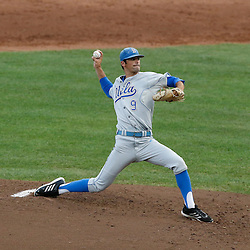 Jun 24, 2013; Omaha, NE, USA; UCLA Bruins starting pitcher Adam Plutko (9) delivers a pitch during the second inning in game 1 of the College World Series finals against the Mississippi State Bulldogs at TD Ameritrade Park. Mandatory Credit: Derick E. Hingle-USA TODAY Sports