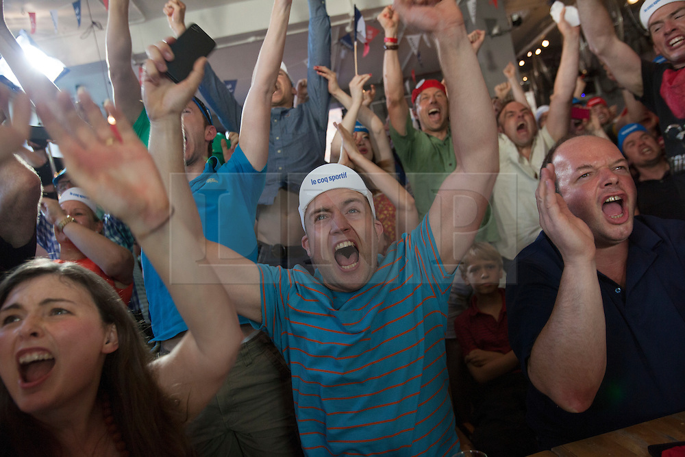 © licensed to London News Pictures. London, UK 22/07/2012. Supporters of Bradley Wiggins watching Tour de France's last seconds at Look Mum No Hands Cafe in central London. Bradley Wiggins becomes the first British rider to win the Tour de France. Photo credit: Tolga Akmen/LNP