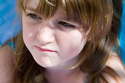 Portrait of a girl looking sad,