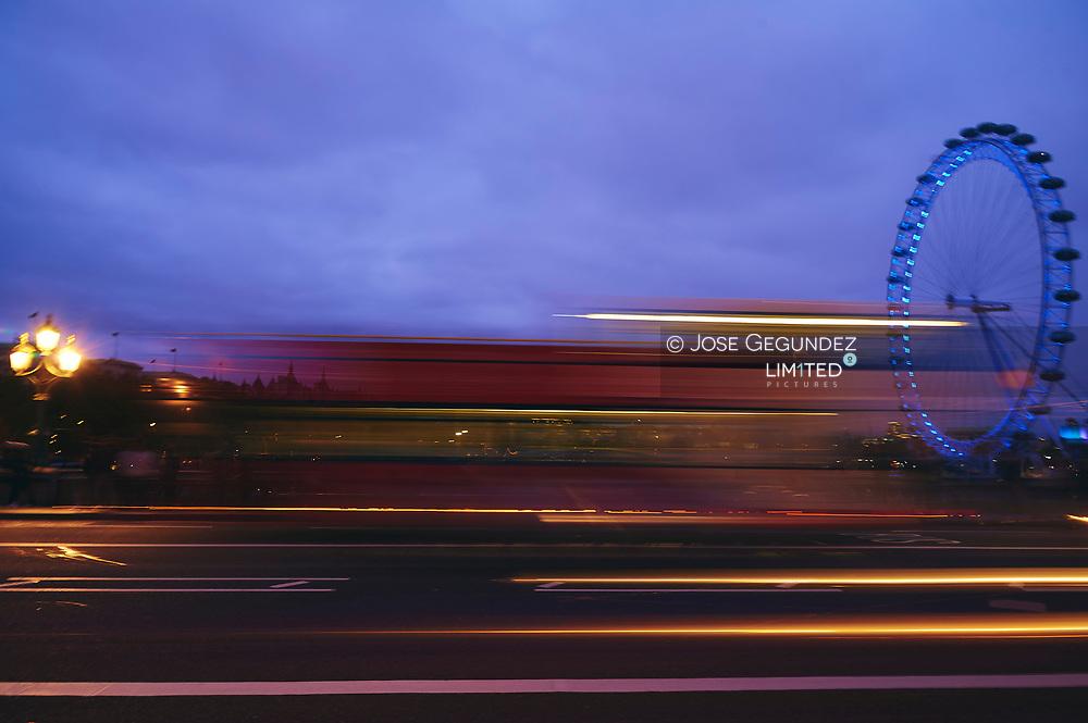 London Eye, skyline and traffic blur on Waterloo Bridge