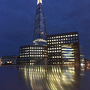 The Shard shot on iPhone 6 at sunset. The light effect is caused by the reflection of light from the metal rail on London Bridge.