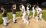CHICAGO - SEPTEMBER 25:  Members of the Chicago White Sox celebrates after the game against the Cleveland Indians on September 25, 2019 at Guaranteed Rate Field in Chicago, Illinois.  (Photo by Ron Vesely/MLB Photos via Getty Images)
