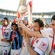 Jubilant Trabzonspor players Teofilo Antonio Gutierrez RONCANCIO (L), Gustavo COLMAN (2ndL), Remzi Giray KACAR (2ndR) lifting up the cup at the ceremony during their after the Turkey Cup final match Trabzonspor between Fenerbahce at the GAP Arena Stadium at Urfa Turkey on wednesday, 05 May 2010. Photo by TURKPIX