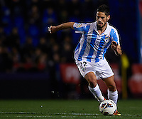 VALENCIA, SPAIN - FEBRUARY 09:  Isco of Malaga runs with the ball during the la Liga match between Levante UD and Malaga CF at Ciutat de Valencia on February 9, 2013 in Valencia, Spain.  (Photo by Manuel Queimadelos Alonso/Getty Images)