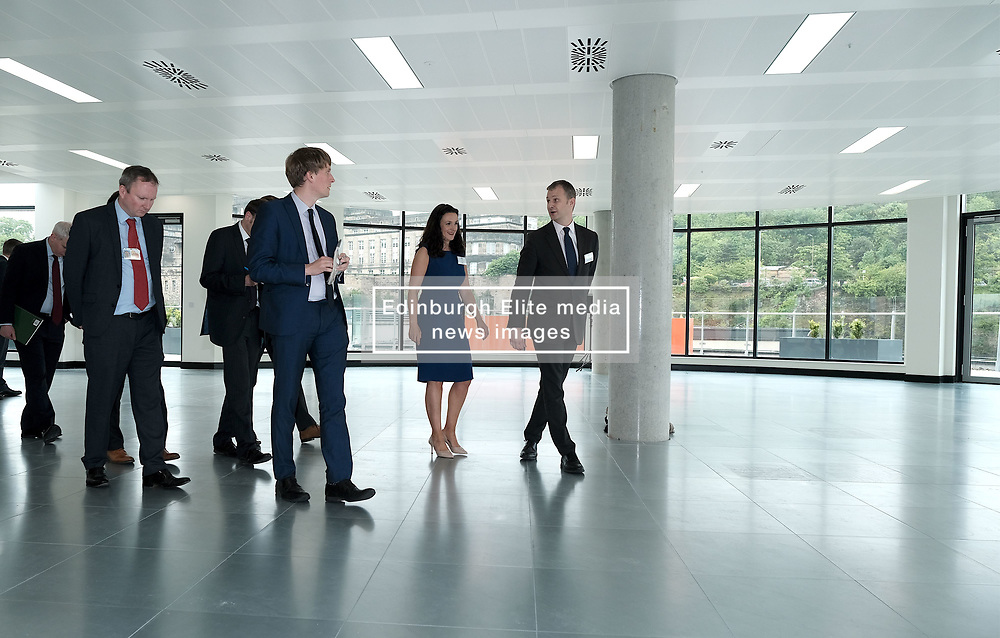 Scottish Secretary of State David Mundell received the keys to the new UK Government building in Edinburgh.<br /> <br /> The new hub is due to open in early 2020 and bring together nearly 3,000 UK Government civil servants.<br /> <br /> Pictured: James Gubbins (Turner & Townsend, right) and Lisa Goldie (HMRC, Blue dress) show journalists around the new building<br /> <br /> Alex Todd | Edinburgh Elite media