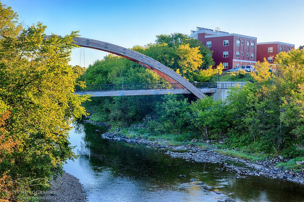 Gateway Crossing pedestrian bridge spans the Meduxnekeag River in Houlton, Maine. HDR.
