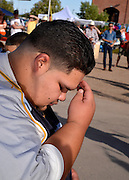 """Celebrants honor Saint John the Baptist, as one who brings seasonal monsoon rain to the desert, at the 16th annual El Dia De San Juan Fiesta at Mercado San Augustin on Monday, June 24, 2013, in Tucson, Arizona, USA. Che Marcello Vindiola, 20, who makes the sign of the cross, says that he participates in the fiesta to, """"cleanse myself for the monsoon."""""""