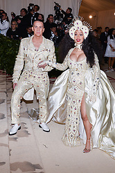 Jeremy Scott and Cardi B walking the red carpet at The Metropolitan Museum of Art Costume Institute Benefit celebrating the opening of Heavenly Bodies : Fashion and the Catholic Imagination held at The Metropolitan Museum of Art  in New York, NY, on May 7, 2018. (Photo by Anthony Behar/Sipa USA)