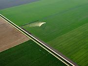Nederland, Flevoland, Lelystad, 26-08-2019; weiland en akkers in Flevoland ten zuidoosten van Lelystad. Er wordt gesproeid tegen de droogte in de late namiddag.<br /> Pastures and fields in Flevoland, southeast of Lelystad. Irrigating against the drought in the late afternoon.<br /> <br /> luchtfoto (toeslag op standard tarieven);<br /> aerial photo (additional fee required);<br /> copyright foto/photo Siebe Swart