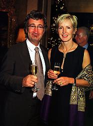 MR & MRS EDDIE JORDAN he owns the Formula 1 motor racing team Jordan, at a party in London on 1st December 1999.MZR 50
