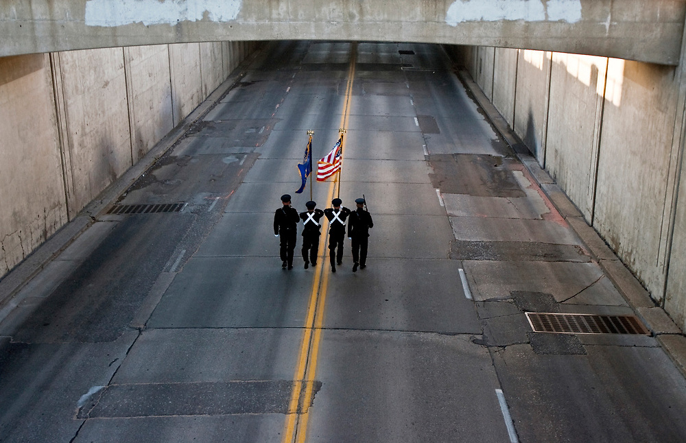 A color guard makes its way through the Eddy Street underpass, opening the Harvest of Harmony parade in downtown Grand Island Saturday morning.(Independent/Matt Dixon)