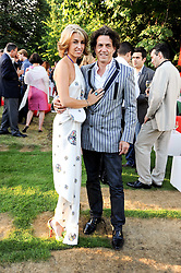 STEPHEN and ASSIA WEBSTER at the annual Serpentine Gallery Summer party this year sponsored by Jaguar held at the Serpentine Gallery, Kensington Gardens, London on 8th July 2010.  2010 marks the 40th anniversary of the Serpentine Gallery and the 10th Pavilion.