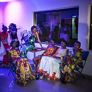 Models wearing a Marcia Creation dress before walking on the runway during the Kinshasa Fashion Week. CAPTA/FEDERICO SCOPPA