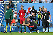 Portugal Forward Cristiano Ronaldo waits to come on field after injury and is bandaged during the Euro 2016 final between Portugal and France at Stade de France, Saint-Denis, Paris, France on 10 July 2016. Photo by Phil Duncan.