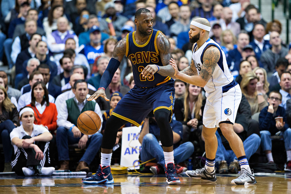 DALLAS, TX - JANUARY 12:  Lebron James #23 of the Cleveland Cavaliers backs his way to the basket while being defended by Deron Williams #8 of the Dallas Mavericks at American Airlines Center on January 12, 2016 in Dallas, Texas.  NOTE TO USER: User expressly acknowledges and agrees that, by downloading and or using this photograph, User is consenting to the terms and conditions of the Getty Images License Agreement.  The Cavaliers defeated the Mavericks 110-107.  (Photo by Wesley Hitt/Getty Images) *** Local Caption *** Lebron James; Deron Williams