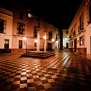 The image was taken around midnight in what is close to the heart of Seville in a neighbor hood near the Santa Cruz Cathedral.