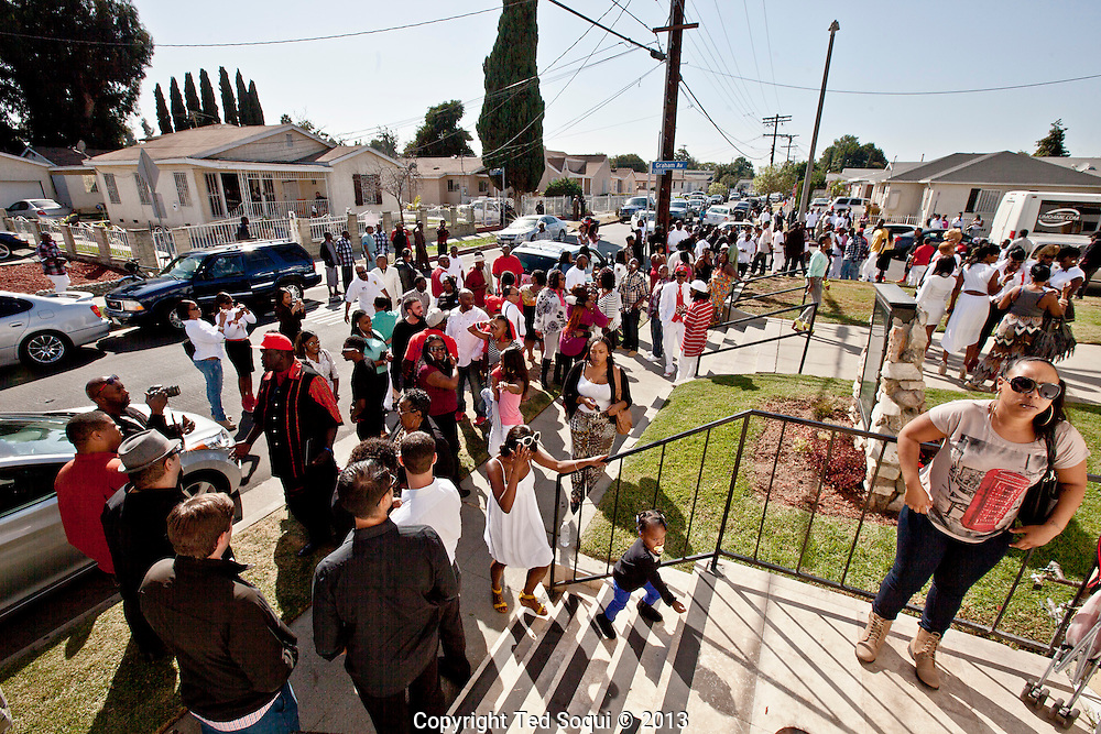"""Friends and family gather on 114th street outside the church.<br /> Funeral services for Kevin """"Flipside"""" White at Macedonia Church in Watts.<br /> White was shot dead in what is believed to be an unprovoked attack during a gang conflict at Watts' Nickerson Gardens and Jordan Downs housing projects.<br /> Flipside, 44, was a founding member of Watts' first major label hip hop act, O.F.T.B. (Operation From The Bottom)."""