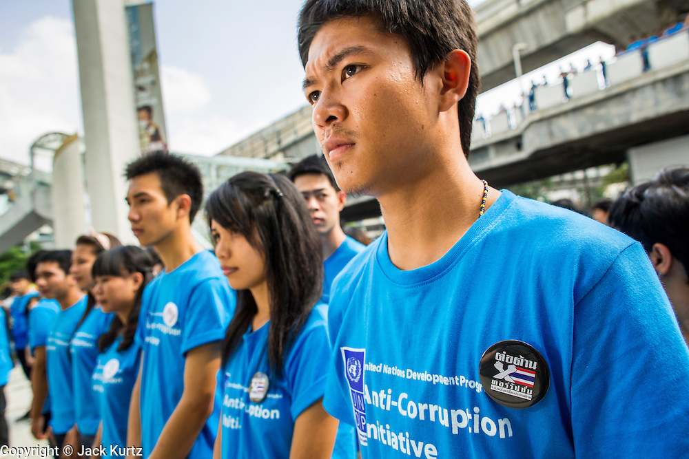 09 DECEMBER 2012 - BANGKOK, THAILAND: Thai college students line up for an anti-corruption rally at the Bangkok Art and Culture Centre (BACC). About 1,500 Thai university students from 90 universities across Thailand attended the rally. The latest Corruption Perceptions Index survey by Transparency International listed Thailand at number 88 out of 176 countries surveyed. The level of corruption in Thailand is perceived to be on the same par as Malawi, Swaziland and Zambia. Thailand's ranking slipped from 80 last year. A series of surveys show that Thais increasingly view corruption as acceptable. A recent ABAC (Assumption Business Administration College, the forerunner to Assumption University, one of the most respected private universities in Thailand) poll reported that a majority (63 per cent) of Thai people hold the view that corruption in government is acceptable as long as they also benefit from it. A majority of young people under 20 now hold the same attitude. International Anti-Corruption Day has been observed annually, on the 9th December, since the passage of the United Nations Convention Against Corruption on 31 October 2003.        PHOTO BY JACK KURTZ